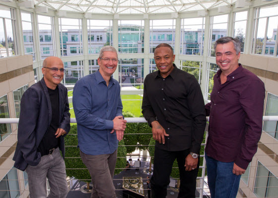Jimmy Iovine, Tim Cook, Dr. Dre and Eddy Cue in Beats acquisition photograph