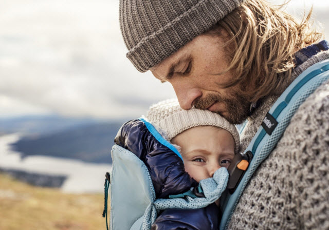 Dad carrying infant in the BabyBjorn One Outdoors